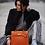 claudia pereira wearing kelly inspiration orange handbag