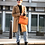 influencer wearing kelly designer inspired orange handbag