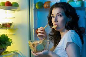 Woman stood at fridge