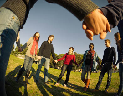Group of individuals holding hands