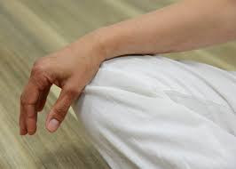 Relaxed hand on knee
