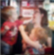 Kid Feeding Mom.jpg