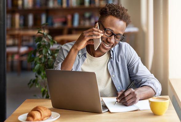 joyful-black-guy-talking-on-smartphone-w