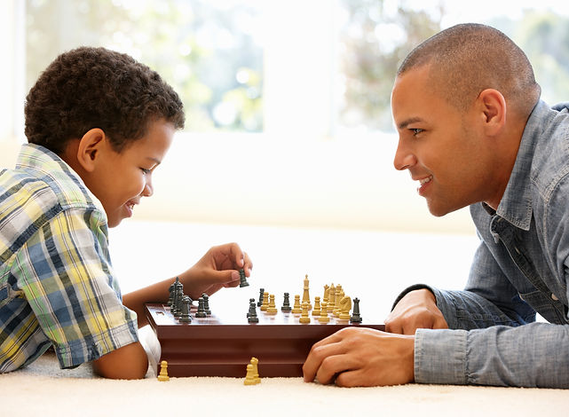 Father child playing chess, homeschool education, family trainig upper elementary