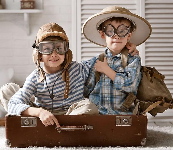 Boys exploring history adventures in suitcase, homeschool