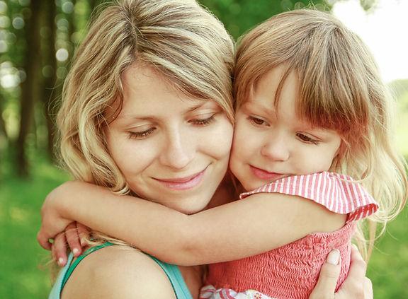 Kindergarten child and mother hugs homeschooling love