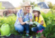 Mother child garden homeschol scienc learning to grow plants