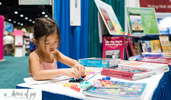 Student using Cornerstone Curriculum products at homeschool convention book fair