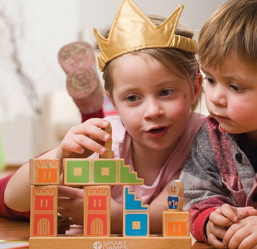Children play IQ logic games together, homeschooling family fun