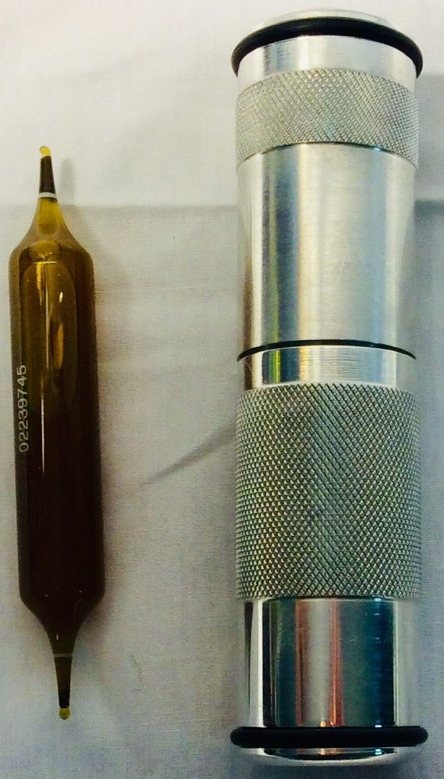 Metal vial holders with glass vials