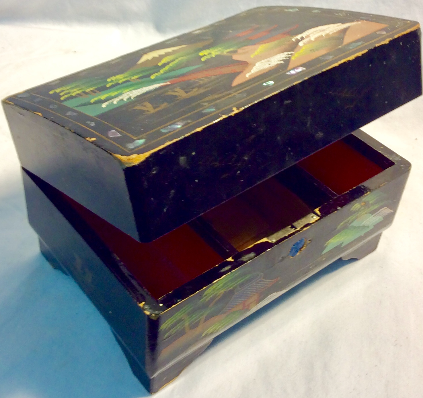 Aged wooden jewelry box with painted asian themed.