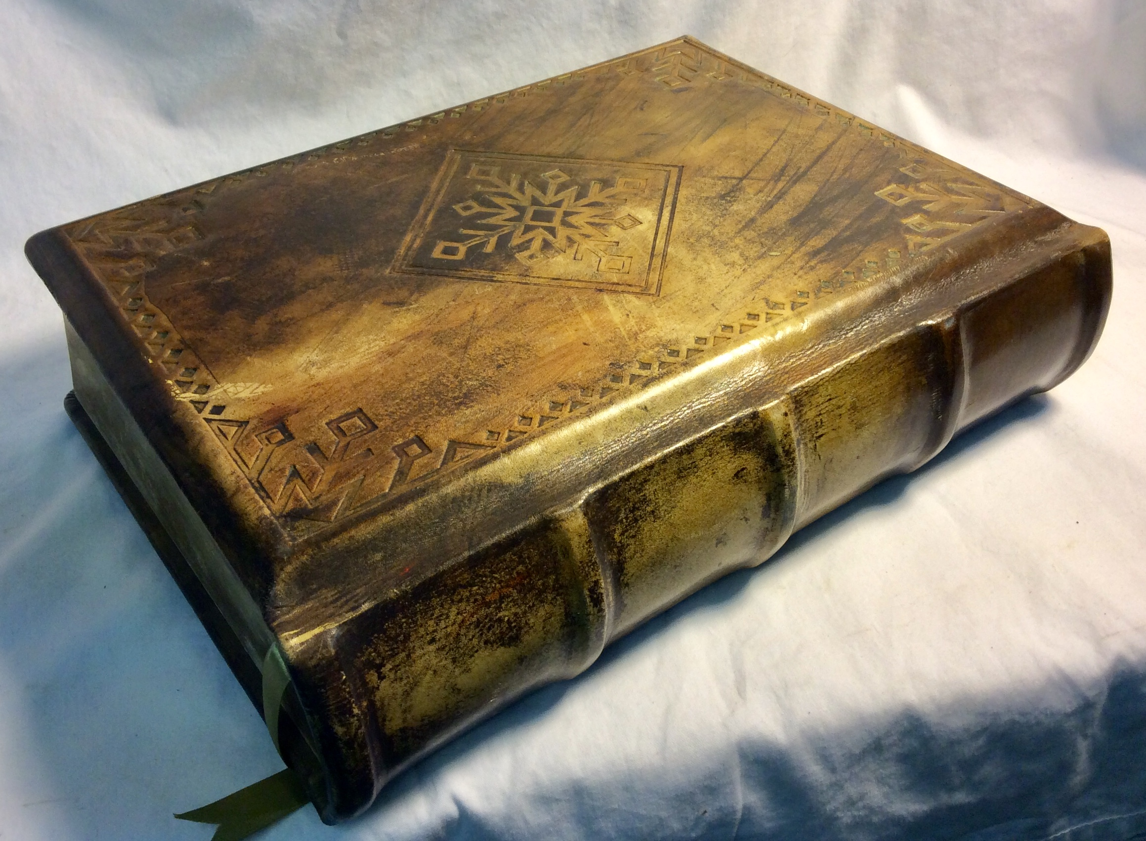 Thick leather covered, brown/gold, magic book with blank pages