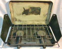 Vintage and aged camping burner stove