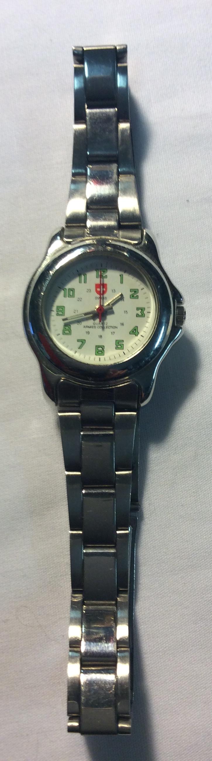 Swiss watch- round white face
