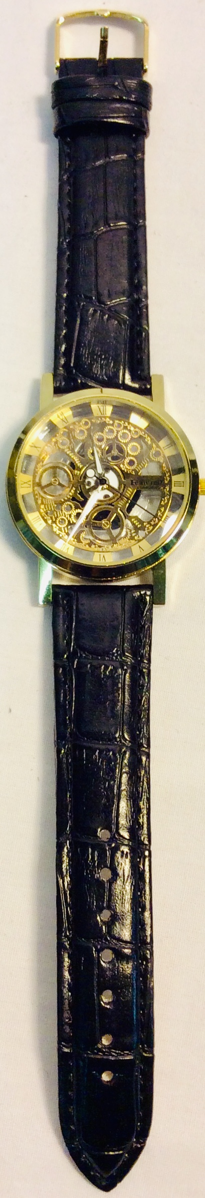 Featurely Golden face with engine details with black leather strap