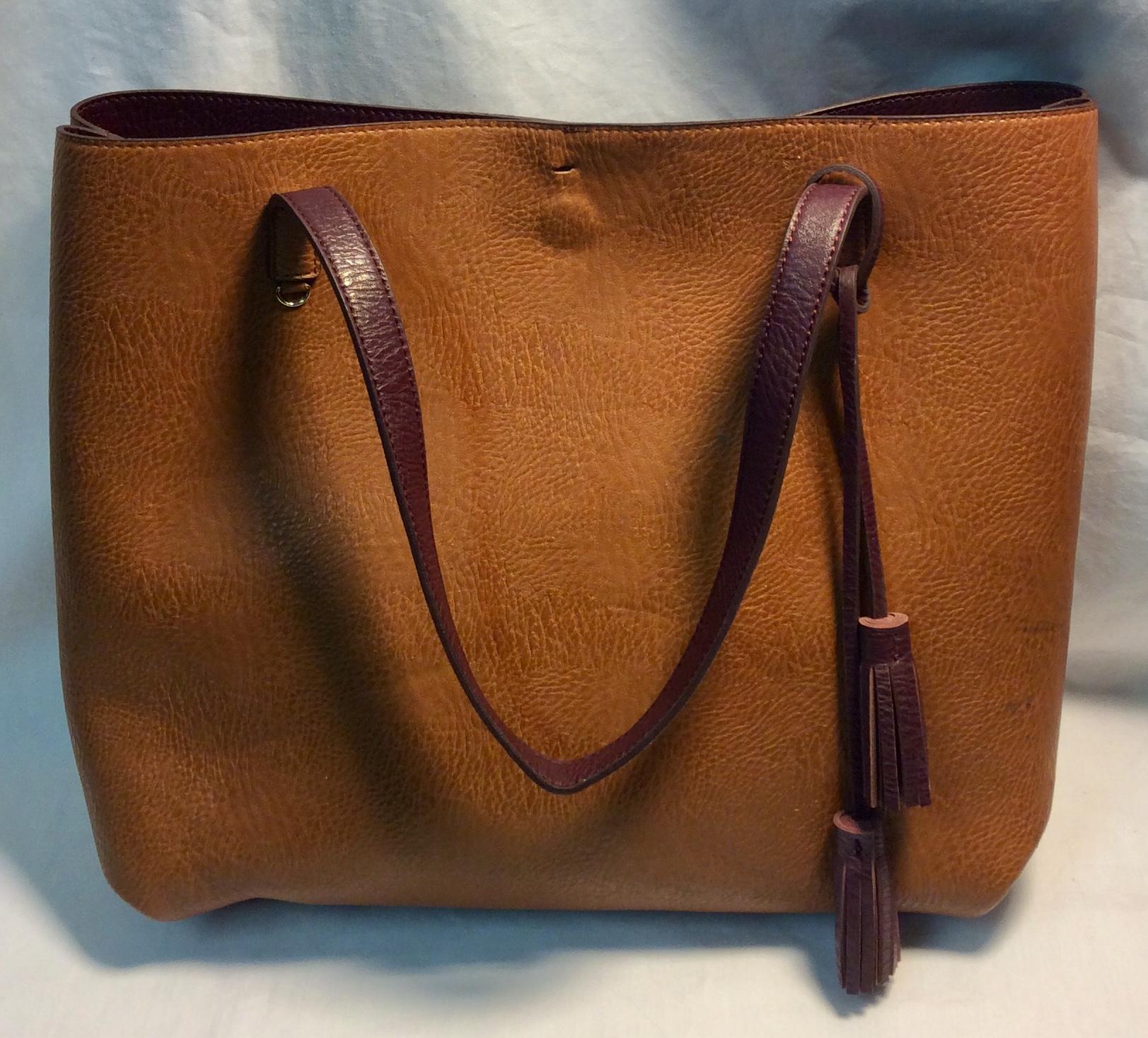 Brown leather bag, maroon interior