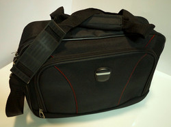 Small black travel bag with red