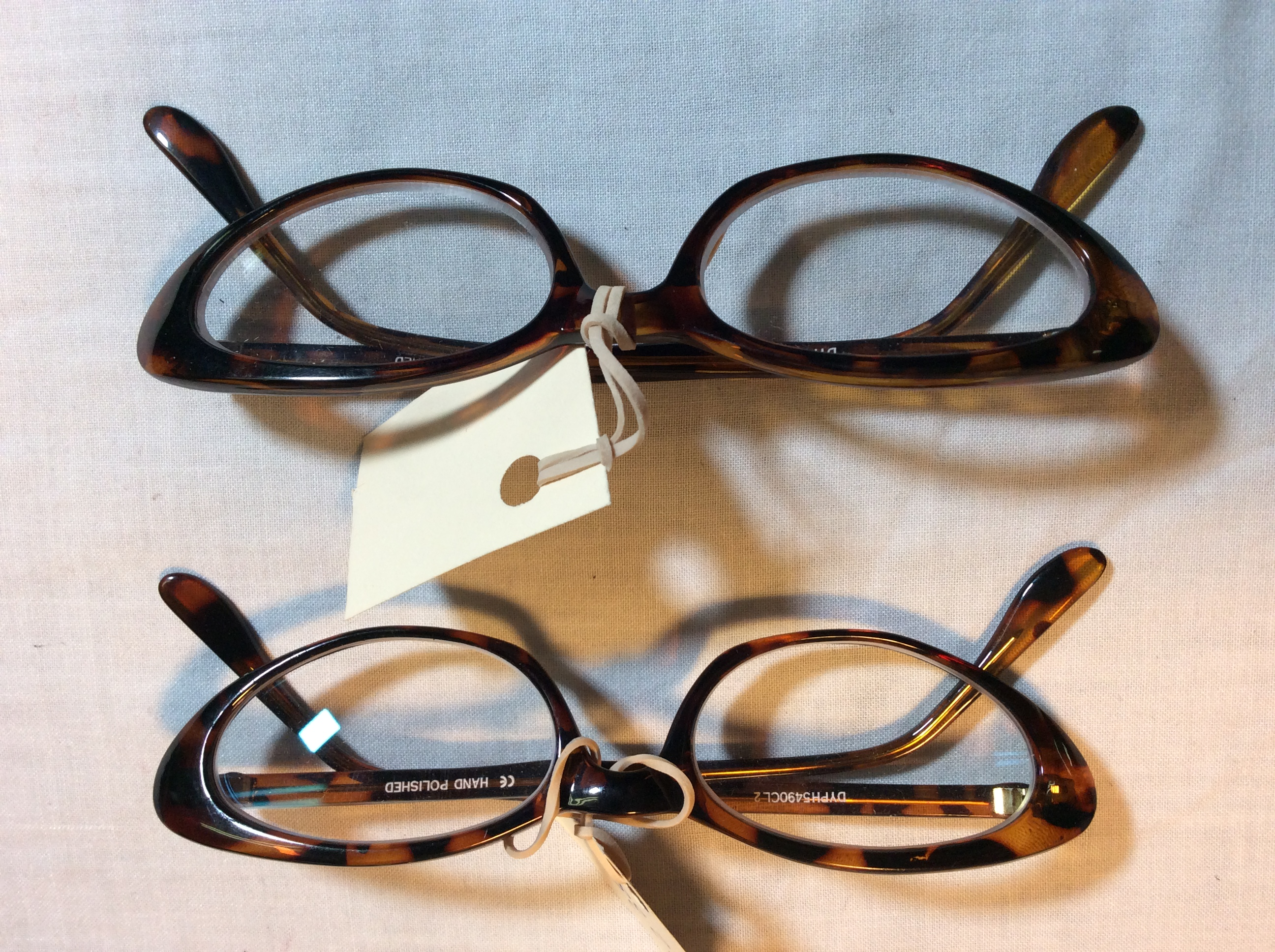 Brown oval rimmed glasses