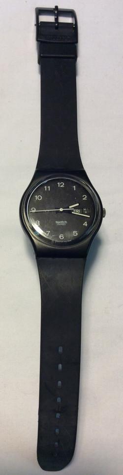 Swatch watch - round black face