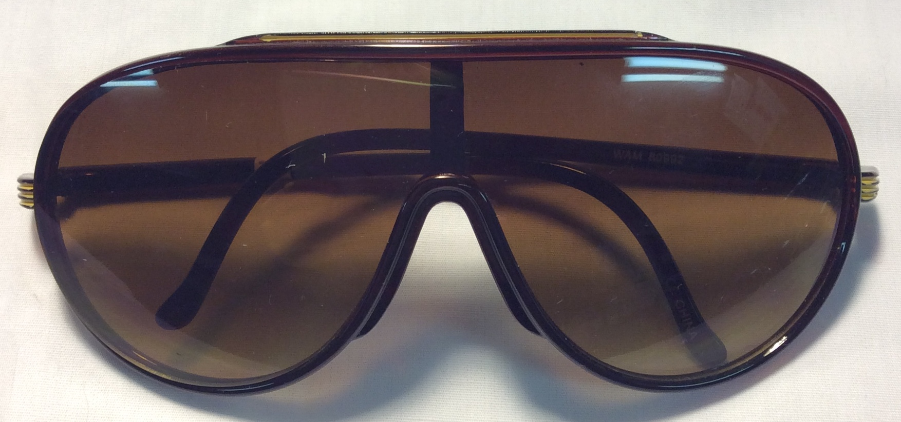 Brown frames with yellow line accent