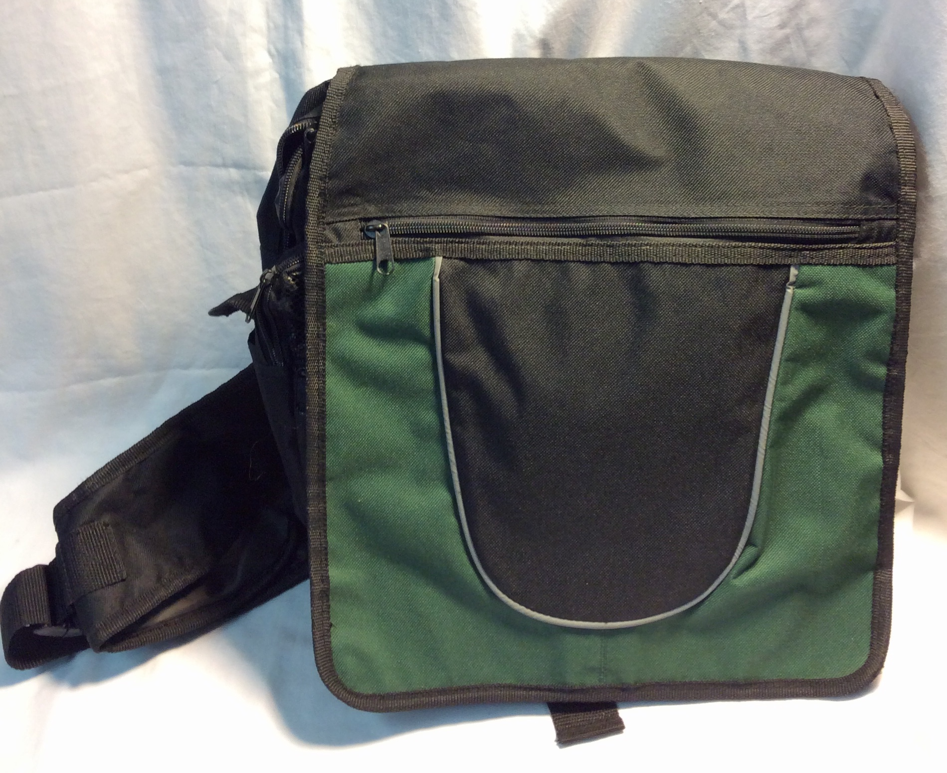 Black side bag with green front flap