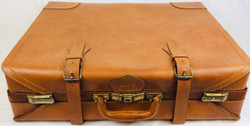Light brown large leather suitcase with double strap