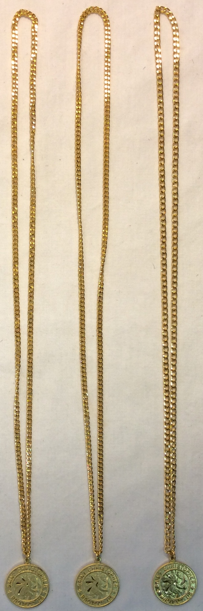 Golden St. Christopher pendants. One sided.