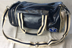 Vintage paramedic duffel bag. White and blue, pleather. Pockets with medical gear smalls