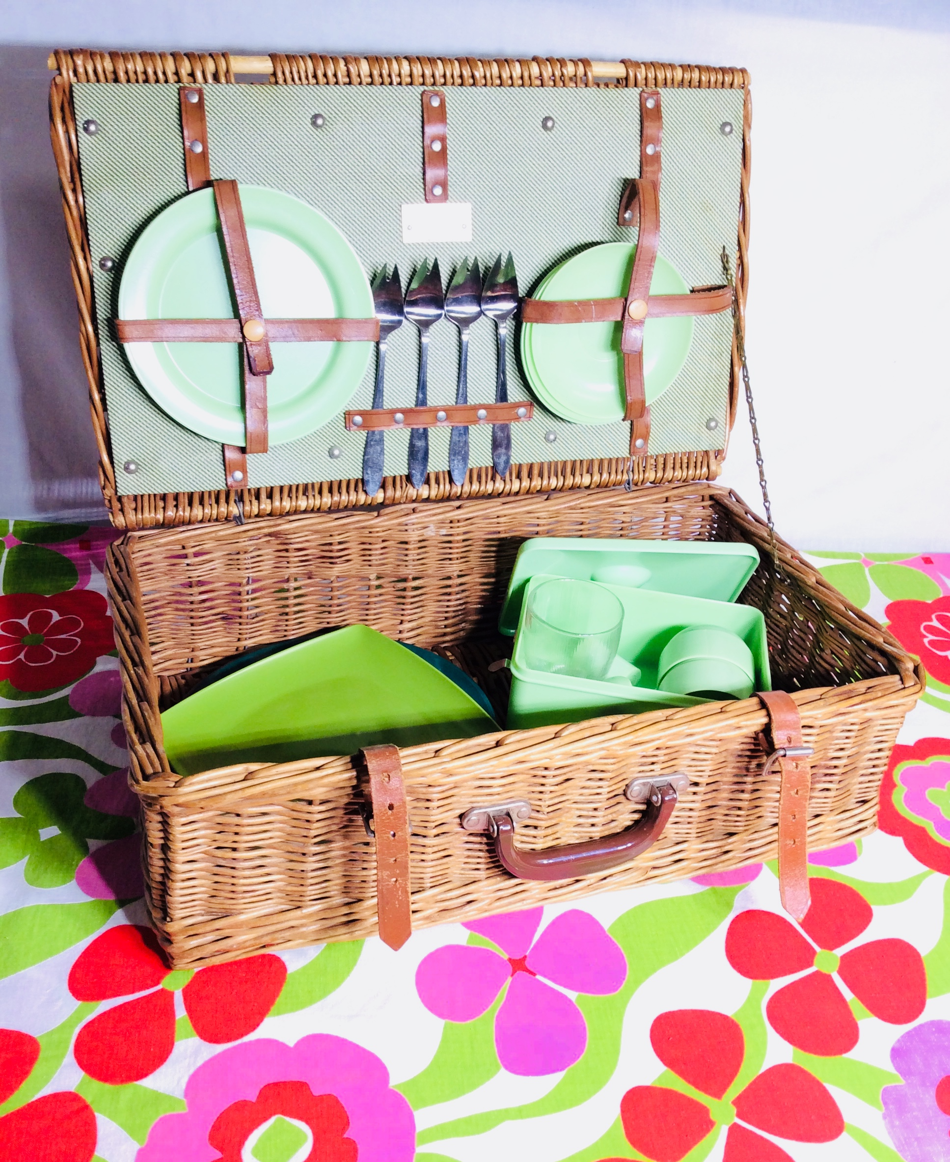 Picnic basket with green tableware