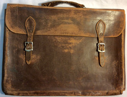 Aged brown leather briefcase