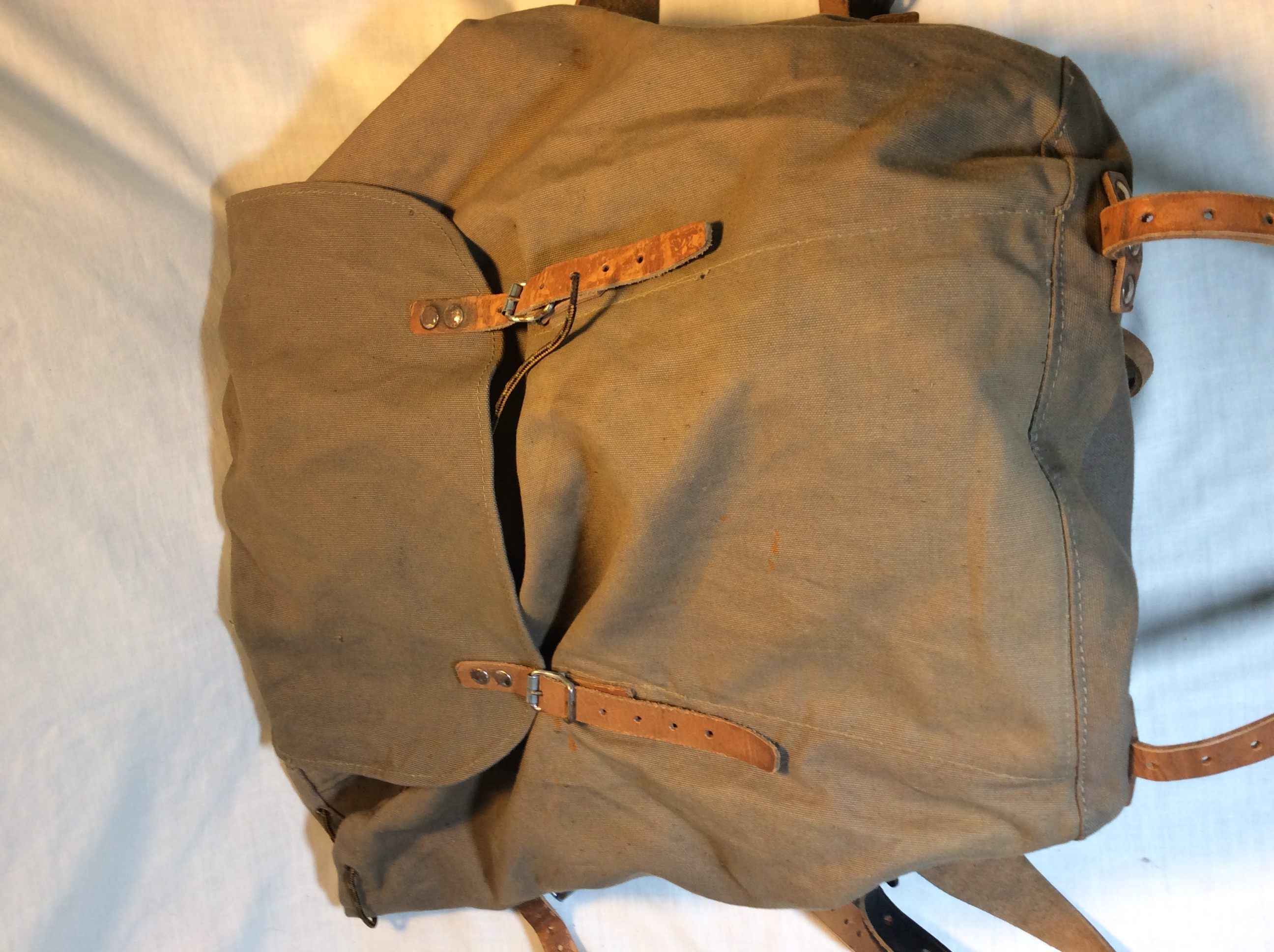 Olive green backpack with leather