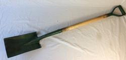 Long green garden shovel. Rubbers and Reals