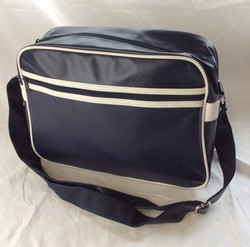 Dark navy faux-leather shoulder-bag with white trim.