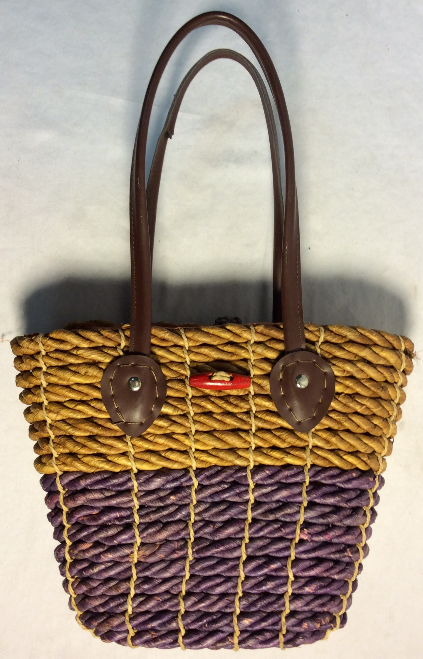 African brown and purple woven purse with fabric interior