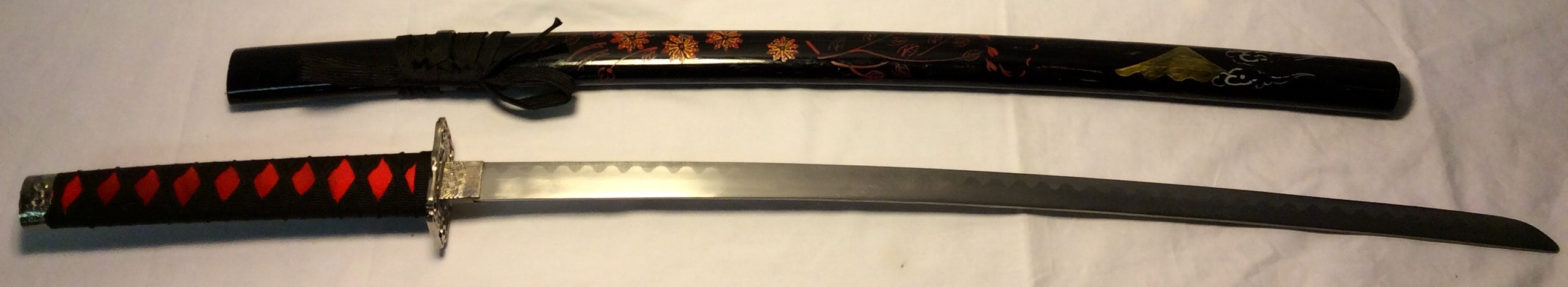 Katana with black saya with flowers