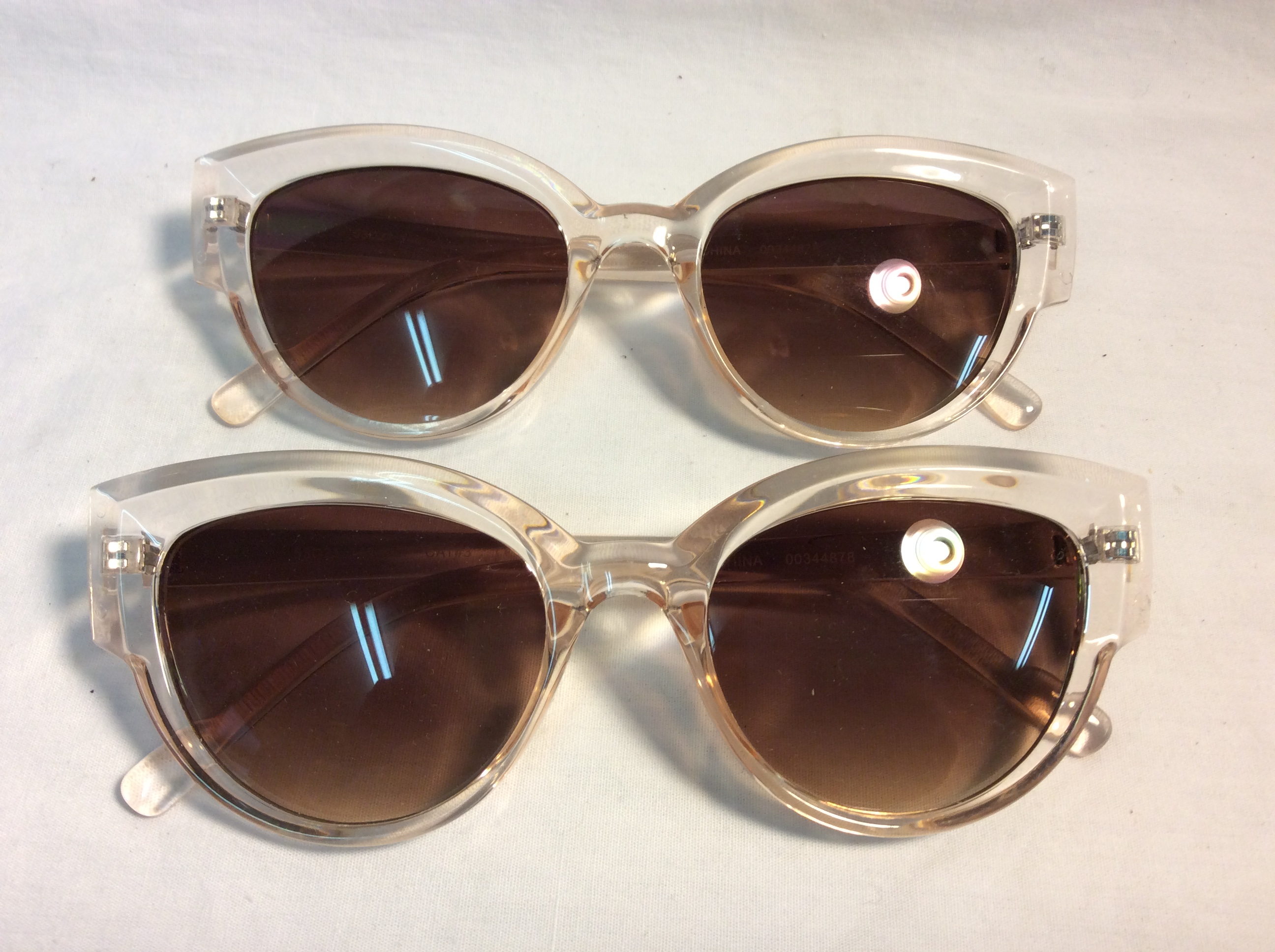Thick light pink frame with brown lenses
