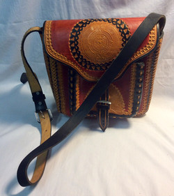 Stiff leather bag with red and black