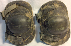 Aged black military tactical elbow with soft pading