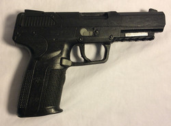 FN57 black soft rubber handguns