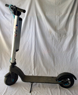 Adult electric scooter with LED lights on the bottom.