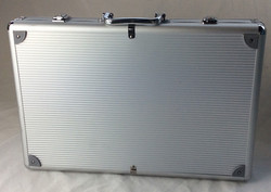 Silver hard shell briefcase with rubber details