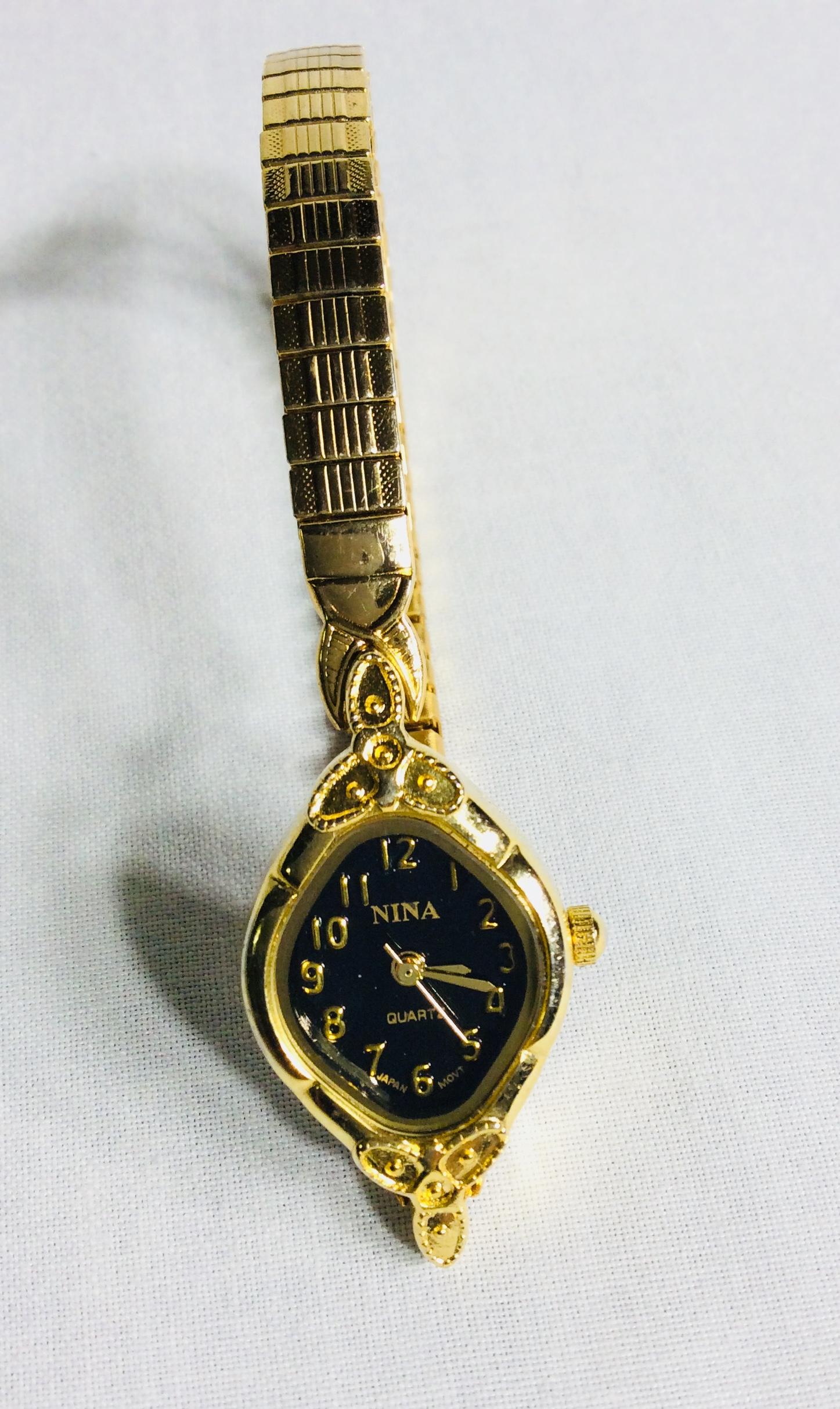 Nina gold watch