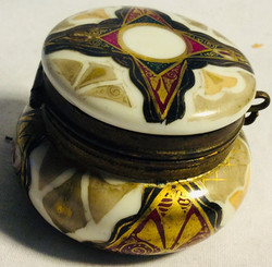 Small porcelain box with metal details