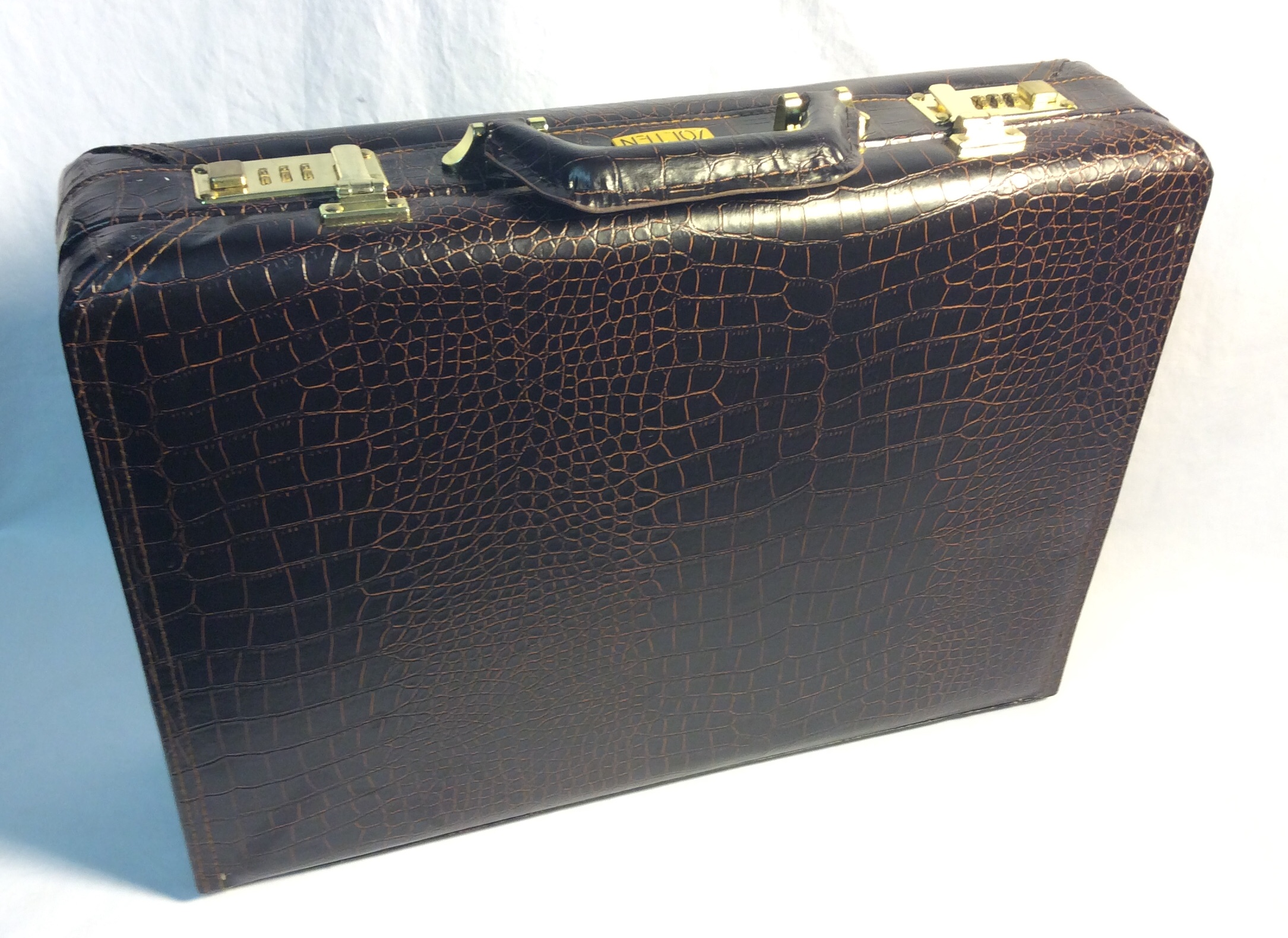 Brown patterned pleather briefcase