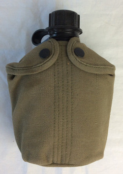 Black canteen in olive canvas casing