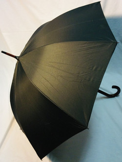 Large black umbrella with wooden handle