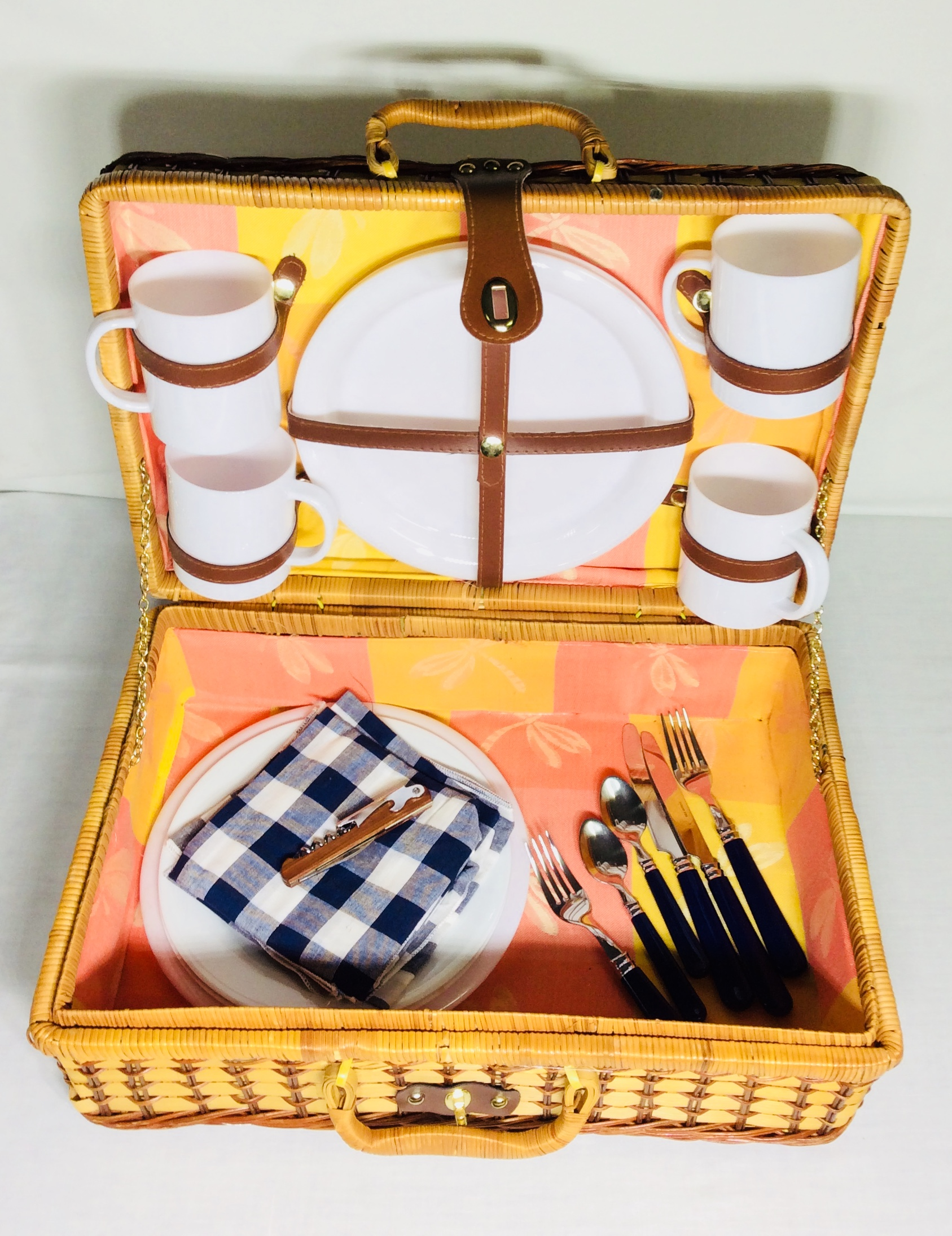Picnic basket with white tableware