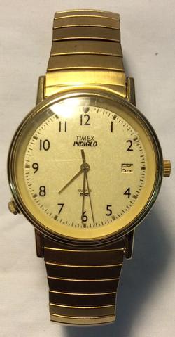 Timex Light gold face, gold casing