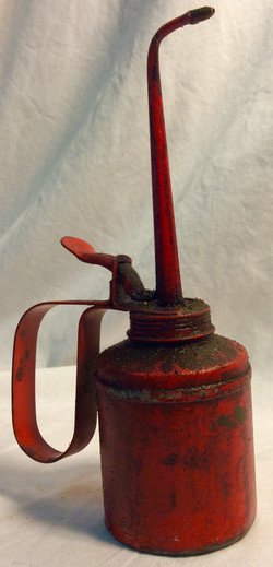 Small, red oil can