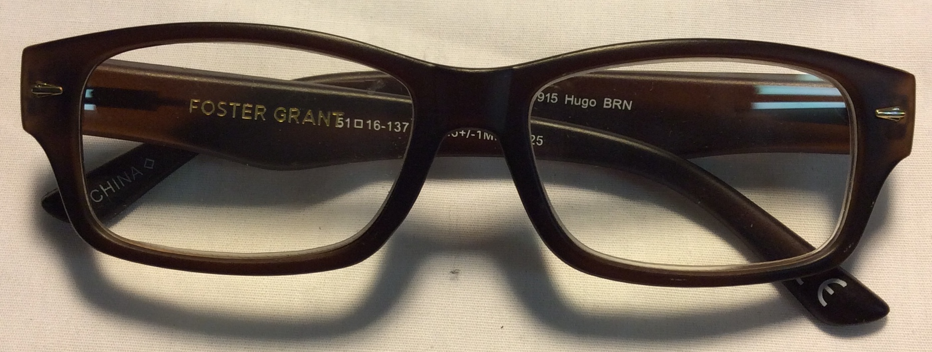Foster Grant Dark brown plastic